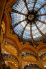 This is the domed inside of Gallerie Lafayette-Mode, a famous department store in Paris.